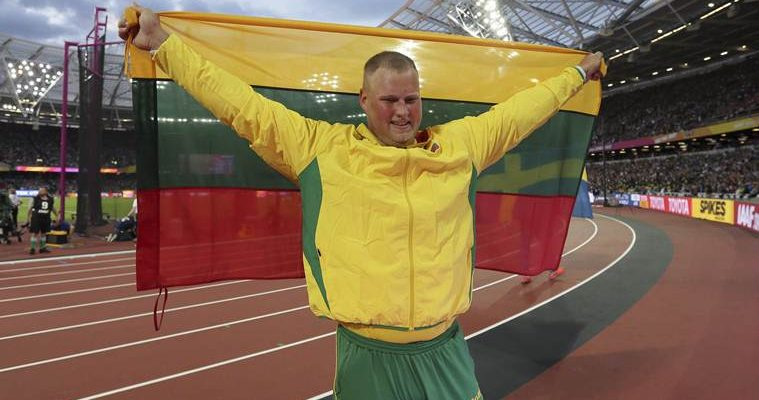 Lithuania's Andrius Gudzius celebrates after winning the Men's Discus Throw final during the World Athletics Championships in London Saturday, Aug. 5, 2017. (AP Photo/Tim Ireland)